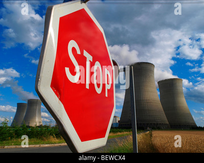 Stop sign with cooling towers of a nuclear power plant in the background, Loire Valley, France - Stock Photo