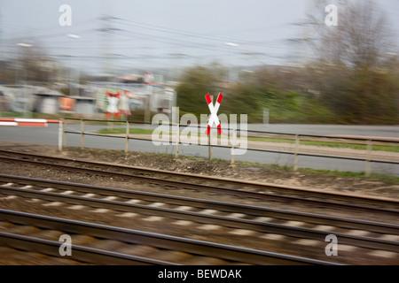 Warning sign near the railway, Berlon, Germany - Stock Photo