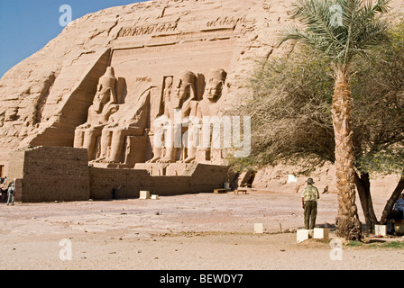 Colossal statues at the Temple of Ramesses II in Abu Simbel, Egypt - Stock Photo