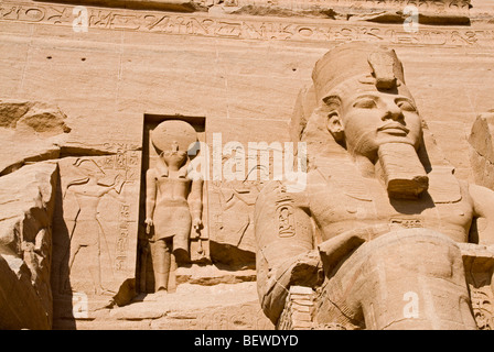 Colossal statue at the Temple of Ramesses II in Abu Simbel Egypt low angle view close-up - Stock Photo
