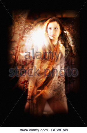Woman standing with abstract pattern in foreground - Stock Photo