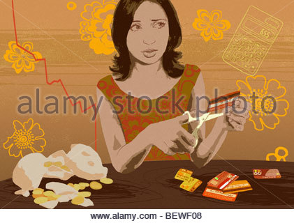 Woman cutting credit cards - Stock Photo