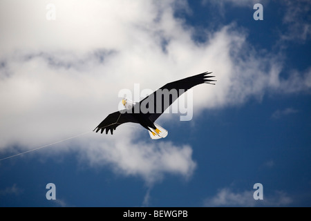 An eagle-shaped kite, at the time of the 'Cervolix' Air Festival (Auvergne- France). Un cerf-volant en forme d'aigle - Stock Photo