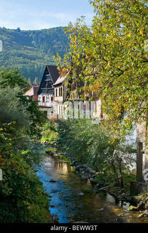 Typical Alsace houses bordering the River Weiss at Kaysersberg Alsace France - Stock Photo