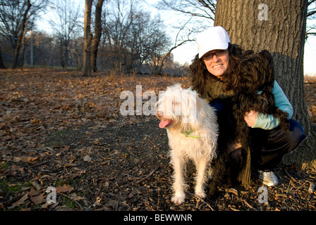 Woman with dogs. - Stock Photo