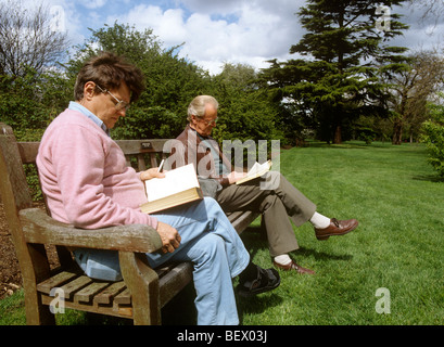 UK, England, London, Kew Gardens Don Chatham and Roger Wenham reading in the gardens - Stock Photo