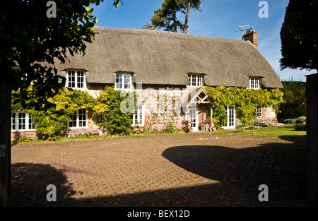 Typical English thatched stone country village cottage in Ogbourne St.George in Wiltshire, England, UK - Stock Photo