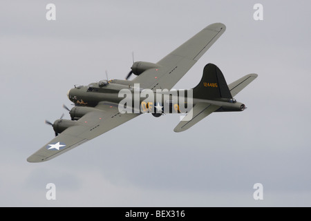 Boeing B-17 flying fortress in flight at Imperial War Museum, Duxford, Cambridgeshire, England, United Kingdom - Stock Photo