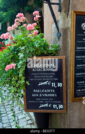 Blackboard menu for typical Alsace delicacy of Choucroute Alsacienne in Riquewihr France - Stock Photo