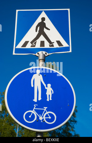 Sign indicating a pedestrian crossing and a pedestrian and light traffic zones in Finland - Stock Photo