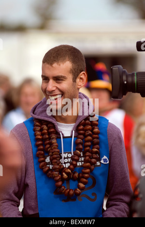 Joel Defries BBC Blue Peter TV presenter competing at the 45th World Conker Championships near Ashton Northamptonshire - Stock Photo