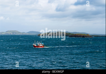 Fishing boat pulling net in the Minch near Ullapool, Scotland - Stock Photo