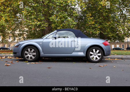 Audi TT Roadster soft top sports car parked among Autumn leaves at The Circus in Bath England October 2009 - Stock Photo