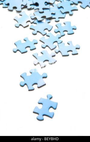 Jigsaw puzzle with pieces spread out on white - Stock Photo