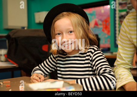 Young pupils dressed in a French national costumes for International Day at a  welsh language medium primary school. - Stock Photo