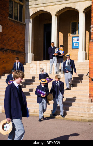 Harrow on the Hill , Harrow School pupils or students in uniform walking in grounds with traditional straw boaters - Stock Photo
