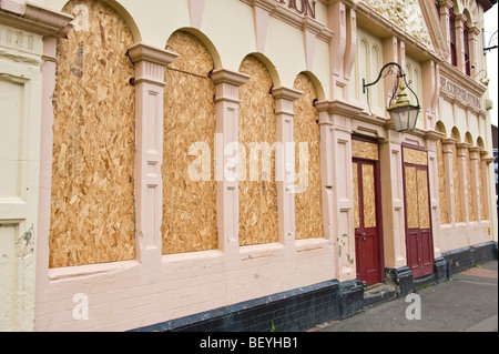 The Corporation pub dated 1898 closed and boarded up in city of Newport South Wales UK - Stock Photo