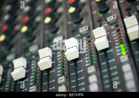 Close up view of a professional sound mixing desk used for mixing live sound. - Stock Photo