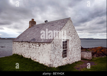 Slate roofed building adjacent to Scurdie Ness Lighthouse near Montrose on the North East Coast of Scotland. - Stock Photo