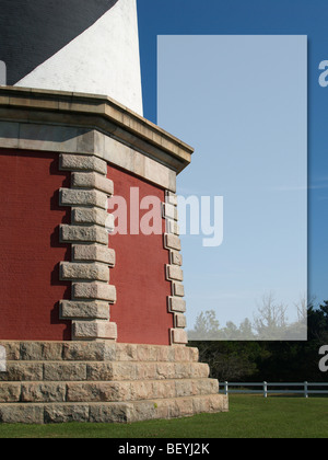 Base of lighthouse with green grass - Stock Photo