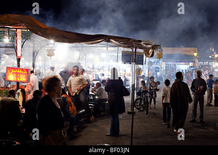 Restaurants serving local food at the Jemaa el Fna main square, Marrakesh, Morocco. - Stock Photo