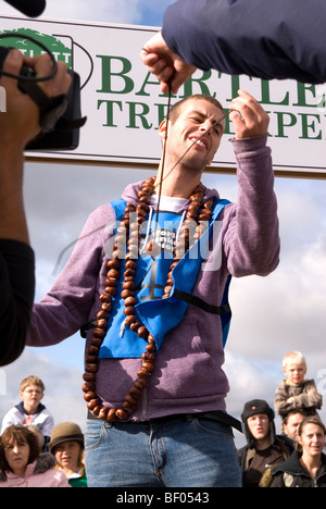 Disappointed BBC Blue Peter TV presenter Joel Defries looses his nut while competing at the 45th World Conker Championships - Stock Photo