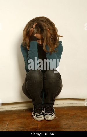 young girl looking distressed. teenager. troubled. anxiety, depression. - Stock Photo