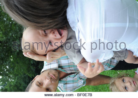 Crying little boy with his parents in a wood - Stock Photo