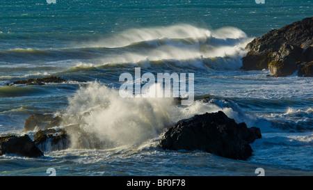 Waves crashing against coastal rocks at Shelter Cove, on the Lost Coast, Humboldt County, California - Stock Photo