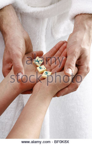 Holding Scrabble Letters - Stock Photo