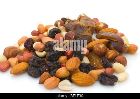Pile Of Mixed Nuts and Dried Fruit Against A White Background - Stock Photo