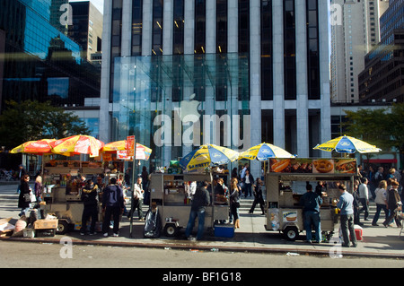 Hot dog vendors line up in front of the midtown Apple Store at the General Motors Building in midtown in New York - Stock Photo
