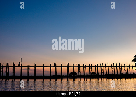 People walking at amarapura bridge at sunset, Mandalay, myanmar. - Stock Photo