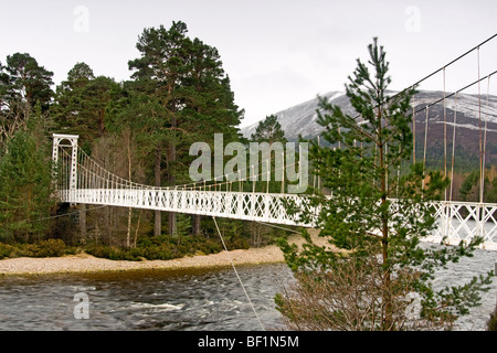 Suspension Footbridge over the River Dee at Inver near Balmoral in Cairngorm National Park Scotland - Stock Photo