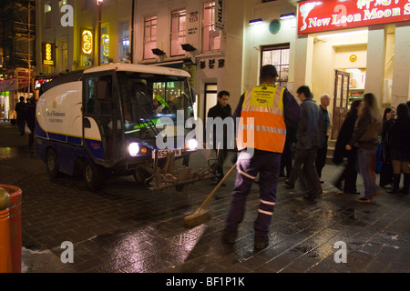 Westminster Street Cleaner in China Town Soho London - Stock Photo