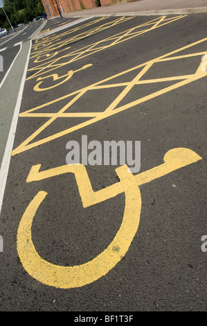 Car parking spaces reserved for disabled drivers in a car park in England. - Stock Photo