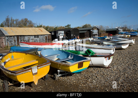 Dinghies on the shore with fishing huts, Orford, Suffolk, England - Stock Photo