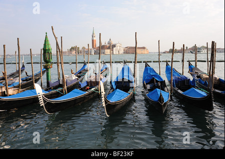 A view of six gondolas moored by the Piazza San Marco in Venice - Stock Photo