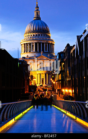 View of St. Paul's Cathedral in London from Millennium Bridge at night - Stock Photo