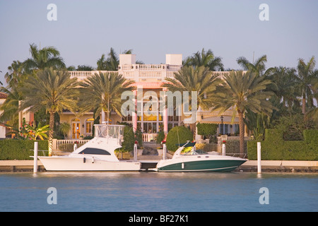 Motorboats in front of villa at Palm Island, Miami, Florida, USA - Stock Photo