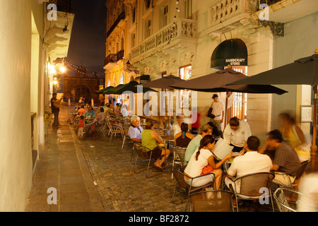 People sitting in front of a cafe at the Old Town in the evening, Calle de Christo, San Juan, Puerto Rico, Carribean, - Stock Photo