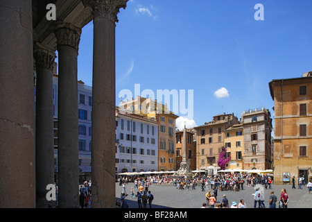 People at Piazza della Rotonda under blue sky, the columns of the Pantheon on the left, Rome, Italy, Europe - Stock Photo