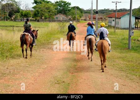 Horseback riding, Fazenda San Francisco, Miranda, Mato Grosso do Sul, Brazil - Stock Photo