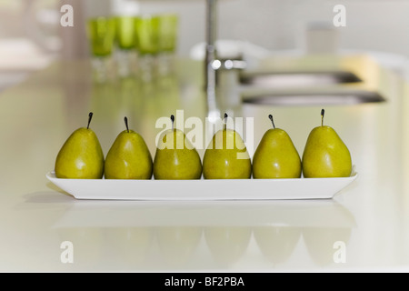 Artificial pears on a table - Stock Photo