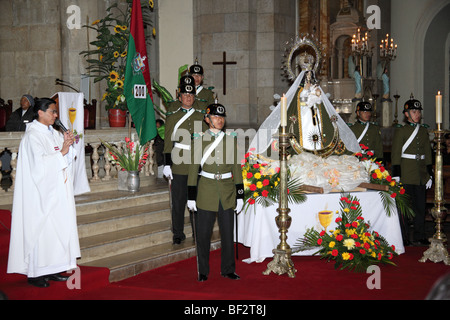 Police guard and the Virgen de Copacabana during mass for the police and Republic on 6th August Independence Day, - Stock Photo