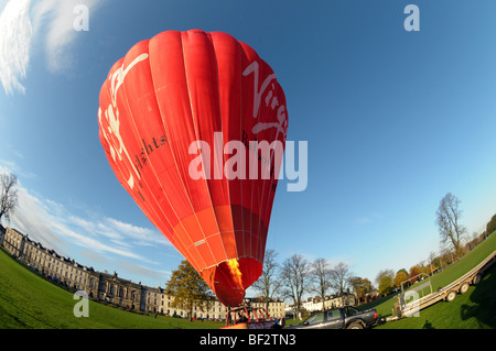 Wide angle view of hot air balloon being inflated before take off. - Stock Photo