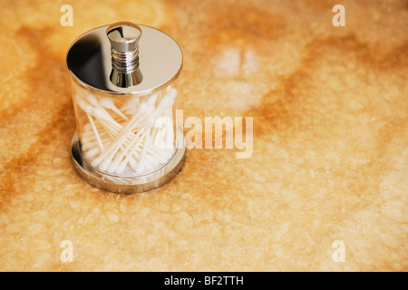 Close-up of cotton swabs in the bathroom - Stock Photo