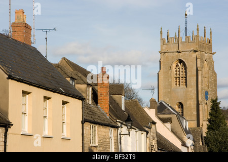 buildings and the tower of Saint Peters Church, Winchcombe, The Cotswolds, Gloucestershire, England - Stock Photo