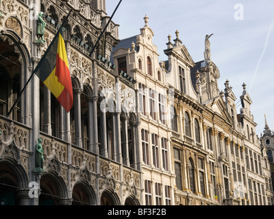 17th century historic facades on the Brussels Grand market square, Belgium, with Belgian flag. - Stock Photo