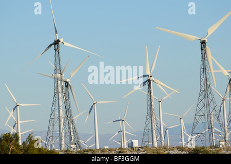 field of wind turbines against blue sky in Palm Springs California, USA - Stock Photo